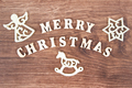 Inscription Merry Christmas with decorations on rustic board, festive time concept - PhotoDune Item for Sale