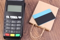 Payment terminal with contactless credit card and paper shopping bag - PhotoDune Item for Sale
