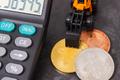 Bitcoins, miniature excavator and calculator - PhotoDune Item for Sale