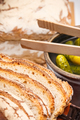 Slices of fresh baked rye or wheat bread and pickled cucumbers for breakfast - PhotoDune Item for Sale