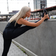 Pretty Woman Doing Stretching Exercise At Sidewalk Railing - PhotoDune Item for Sale