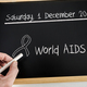 Free Download Written on a chalk slate date of celebration of the World AIDS Day of 2018, conceptual image Nulled