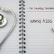 Free Download Stethoscope on notebook and pencil with world aids day words as Nulled