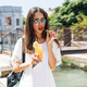 Beautiful young woman eating healthy food on travel vacation - PhotoDune Item for Sale