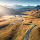 Winding road in mountain valley at sunset in autumn. Aerial view - PhotoDune Item for Sale