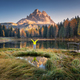 Free Download Man with raised up arms on Antorno lake in autumn at sunrise Nulled
