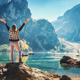 Free Download Woman with raised up arms on the coast of Braies lake Nulled