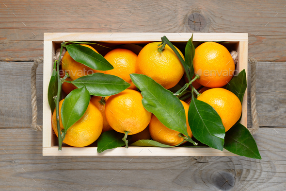 Mandarins in wooden box top view - Stock Photo - Images