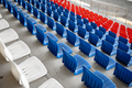 Empty stands with rows of plastic seats in the stadium - PhotoDune Item for Sale