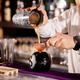 Bartender bartender is pouring a drink - PhotoDune Item for Sale