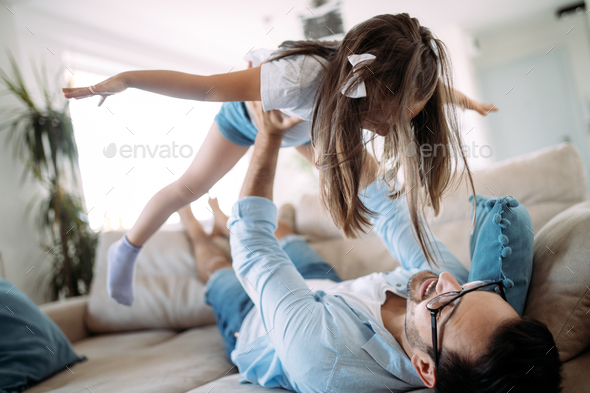Happy family having fun time at home - Stock Photo - Images