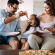 Free Download Portrait of happy family sharing pizza at home Nulled