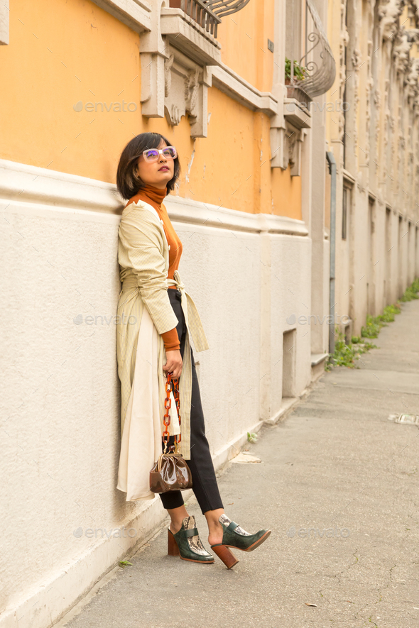 Indian woman posing in an urban context - Stock Photo - Images