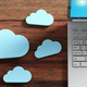 Cloud computing, Computer and blue clouds on wooden background. 3d illustration - PhotoDune Item for Sale