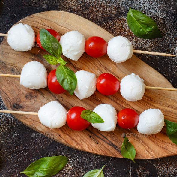 Italian cheese mozzarella with tomatoes, basil and olive oil - Stock Photo - Images