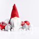 Christmas composition with gnome and festive decorations on a wh - PhotoDune Item for Sale