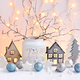 Christmas composition with toy houses, lights,  twigs and festiv - PhotoDune Item for Sale