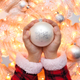 Christmas decoration ball in the children's hands against the ba - PhotoDune Item for Sale