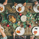 Friends or family eating at festive Christmas table, top view - PhotoDune Item for Sale