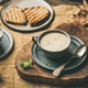 Warming celery cream soup and grilled bread over linen tablecloth - PhotoDune Item for Sale