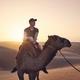 Camel riding in desert - PhotoDune Item for Sale