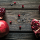 Fresh red pomegranate and grapefruit On a wooden background. Pomegranate in plate on wood background - PhotoDune Item for Sale