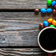 colored sweets with coffee on a wooden background - PhotoDune Item for Sale