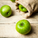 fruit. Ripe green apples with burlap, on wooden  backgroun - PhotoDune Item for Sale
