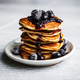Picture of few pancakes with blackberries and sugar on wooden background - PhotoDune Item for Sale