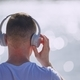 Young man with headphones listening - PhotoDune Item for Sale
