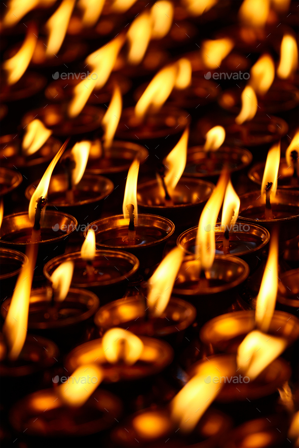 Burning candles in Buddhist temple. Dharamsala, Himachal Pradesh - Stock Photo - Images