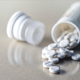 White pills out of a bottle, conceptual image - PhotoDune Item for Sale