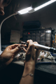 girl master processes the metal plate in the home workshop - PhotoDune Item for Sale