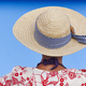 Summer time. Woman with straw hat. Blue background. Relaxing time - PhotoDune Item for Sale