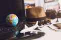Toy airplane on laptop keyboard with globe and camera - PhotoDune Item for Sale
