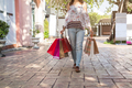 Young woman with shopping bags at shopping mall on black friday, Woman lifestyle concept - PhotoDune Item for Sale