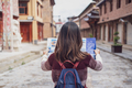 Young woman traveler walking in the old town, Shangri-la and looking the map, Travel concept - PhotoDune Item for Sale