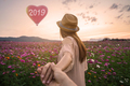 Young woman traveler holding man's hand and leading him, New Year 2019 celebration concept - PhotoDune Item for Sale