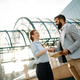 Free Download Picture of handsome man and beautiful woman as business partners Nulled