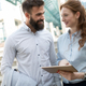 Free Download Young business couple walking outdoor near office building Nulled