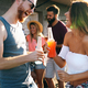 Free Download Friends having fun and drinking outdoor on a rooftop get together Nulled