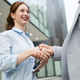 Free Download Successful business people handshaking closing a deal Nulled