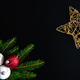 Christmas background with balls, golden snowflake, fir tree branches on black - PhotoDune Item for Sale