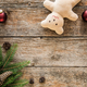 Christmas background. Ornaments, teddy bear and fir tree on wooden background - PhotoDune Item for Sale