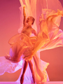 Ballerina. Young graceful female ballet dancer dancing over red studio. Beauty of classic ballet. - PhotoDune Item for Sale