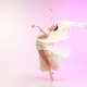 Ballerina. Young graceful female ballet dancer dancing over pink studio. Beauty of classic ballet. - PhotoDune Item for Sale