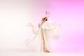 Ballerina. Young graceful female ballet dancer dancing over pink studio. Beauty of classic ballet. - PhotoDune Item for Sale