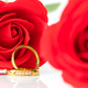 Close up Red roses and gold rings on white_-10 - PhotoDune Item for Sale