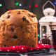 Free Download Festive homemade panettone cake on Christmas table Nulled