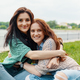 portrait of two pretty girl friends smiling hugs and having fun - PhotoDune Item for Sale